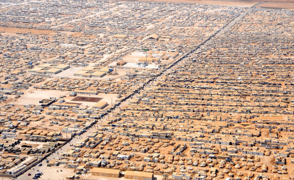 """An Aerial View of the Za'atri Refugee Camp"" by U.S. Department of State - http://www.flickr.com/photos/statephotos/9312291491/sizes/o/in/photostream/. Licensed under Public Domain via Commons - https://commons.wikimedia.org/wiki/File:An_Aerial_View_of_the_Za%27atri_Refugee_Camp.jpg#/media/File:An_Aerial_View_of_the_Za%27atri_Refugee_Camp.jpg"